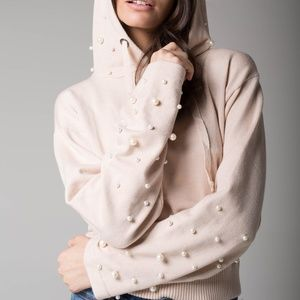 Hooded sweater embellished with pearls